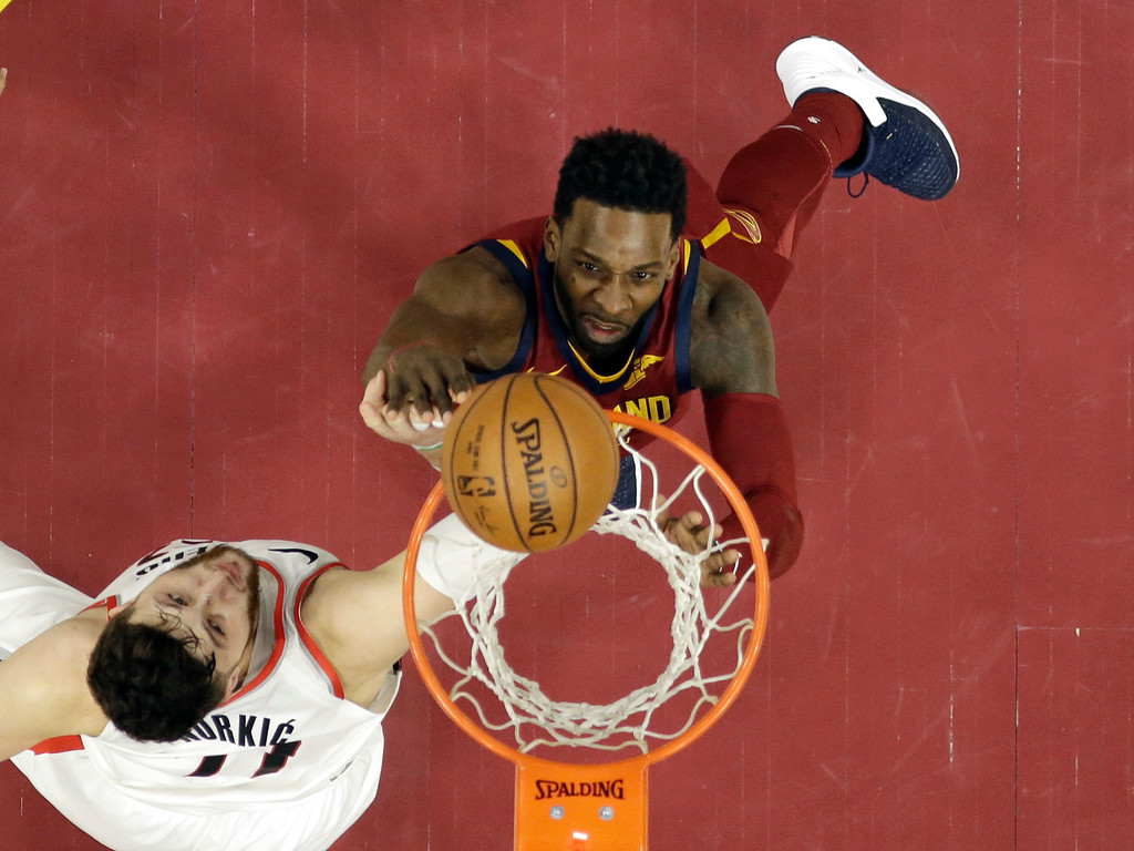 . Cleveland Cavaliers\' Jeff Green, right, drives to the basket against Portland Trail Blazers\' Jusuf Nurkic, from Bosnia Herzegovina, in the second half of an NBA basketball game, Tuesday, Jan. 2, 2018, in Cleveland. The Cavaliers won 127-110. (AP Photo/Tony Dejak)