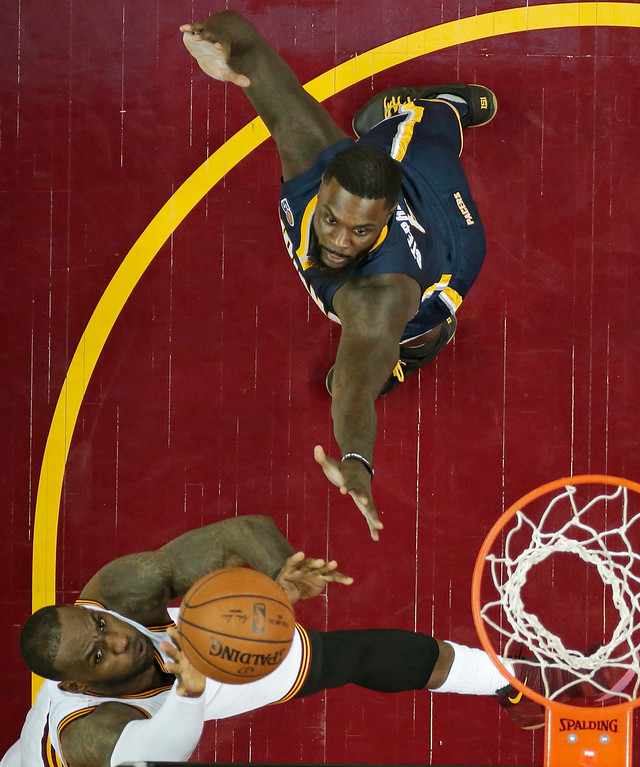 . Cleveland Cavaliers\' LeBron James, left, drives to the basket against Indiana Pacers\' Lance Stephenson in the first half in Game 1 of a first-round NBA basketball playoff series, Saturday, April 15, 2017, in Cleveland. (AP Photo/Tony Dejak)