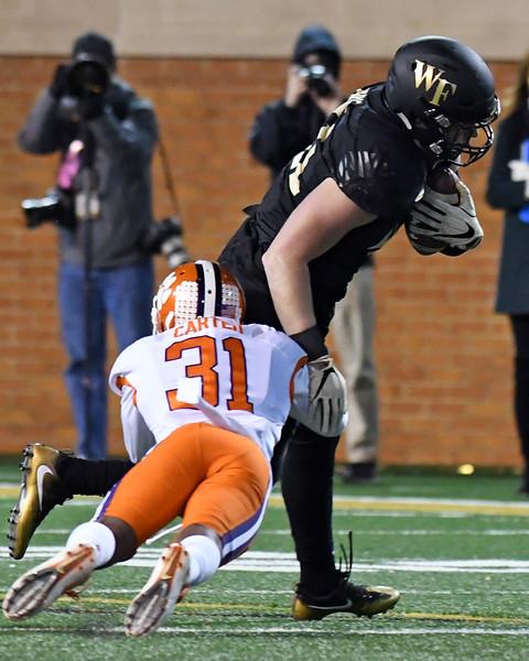 Devin Pike tackled R Carter after catch.jpg