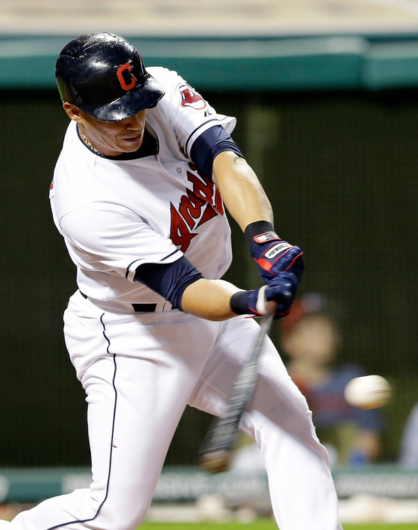. Cleveland Indians\' Asdrubal Cabrera hits a three-run home run off Detroit Tigers relief pitcher Ian Krol in the eighth inning of a baseball game on Friday, June 20, 2014, in Cleveland. Indians\' Mike Aviles and Michael Bourn also scored on the hit. (AP Photo/Tony Dejak)