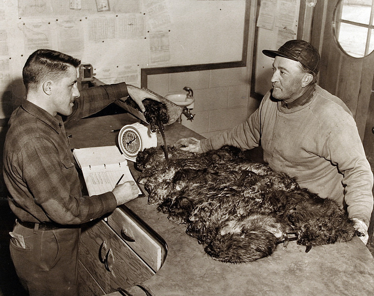 Uncle Fritz & Pete Potosky Checking his Muskrats.JPG