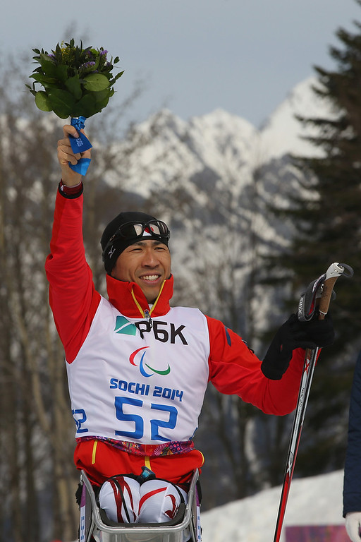 . Kozo Kubo of Japan celebrates winning the bronze medal in the men\'s 7.5km sitting Biathlon during day one of Sochi 2014 Paralympic Winter Games at Laura Cross-country Ski & Biathlon Center on March 8, 2014 in Sochi, Russia.  (Photo by Mark Kolbe/Getty Images)