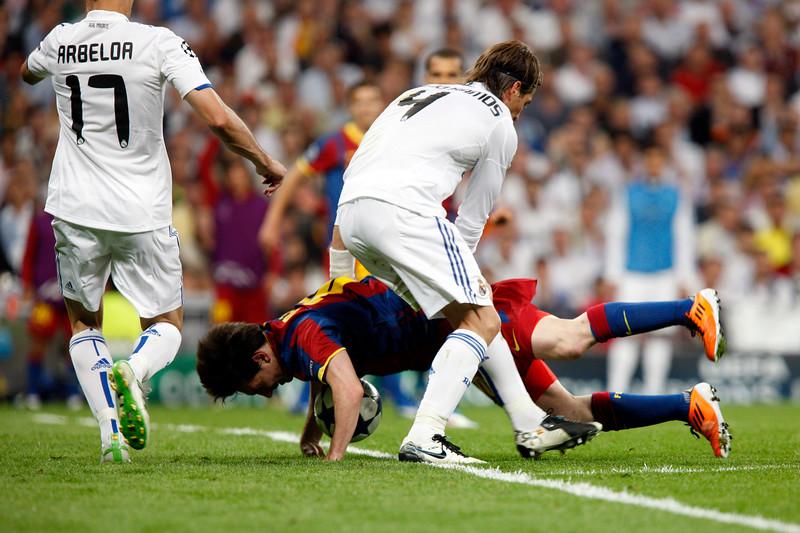 Messi falling down, UEFA Champions League Semifinals game between Real Madrid and FC Barcelona, Bernabeu Stadiumn, Madrid, Spain