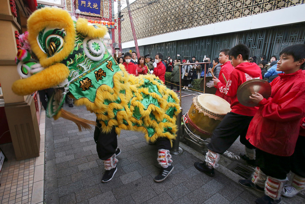 . Lion dancers perform as they celebrate the Chinese Lunar New Year, parading through China Town in Yokohama, near Tokyo Friday, Feb. 16, 2018. (AP Photo/Koji Sasahara)