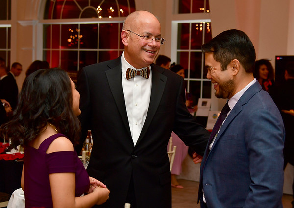 11/17/2018 Mike Orazzi | Staff Dr. Margarita Reyes and her husband Bryon Liam talk with Bristol Hospital Present and CEO Kurt Barwis (center) during Bristol Hospitals Annual Ball held at the Aqua Turf Club in Southington. All proceeds will benefit the Emergency Center expansion and renovation project.