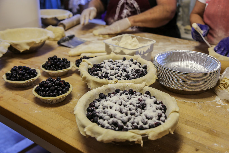 table with freshly made pies