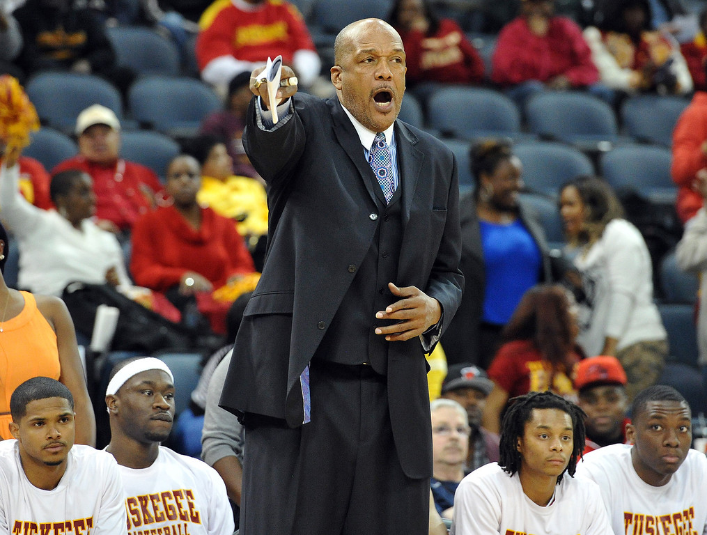 . Tuskegee head coach Leon Douglas shouts out instructions to his players as they take on Metro State during the first half of the NCAA Div. II quarterfinals of the Elite Eight menís basketball tournament at the Ford Center in Evansville, Ind., Wednesday, March 26, 2014.  (AP Photo/The Evansville Courier & Press, Jason Clark)