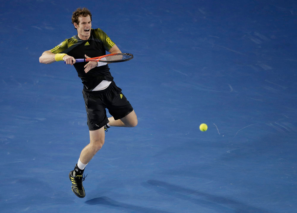 . Britain\'s Andy Murray makes a backhand return to Serbia\'s Novak Djokovic during the men\'s final at the Australian Open tennis championship in Melbourne, Australia, Sunday, Jan. 27, 2013. (AP Photo/Rob Griffith)