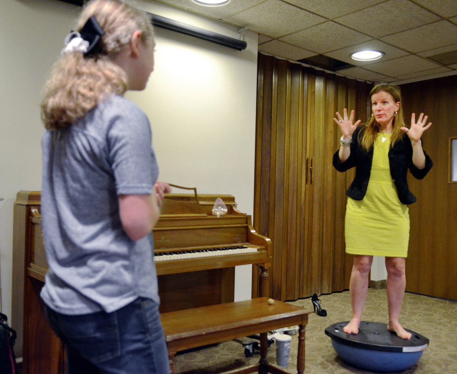 . Jeff Forman/JForman@News-Herald.com Heidi Skok stands on a Bosu ball to demonstrate breathing technique as she gives a voice lesson April 14 to Michaela Quick, 15, at the Willoughby Fine Arts Association.