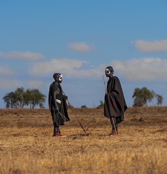 Two masai youngsters during their rites of passage out in the wild.  Tanzania, 2019