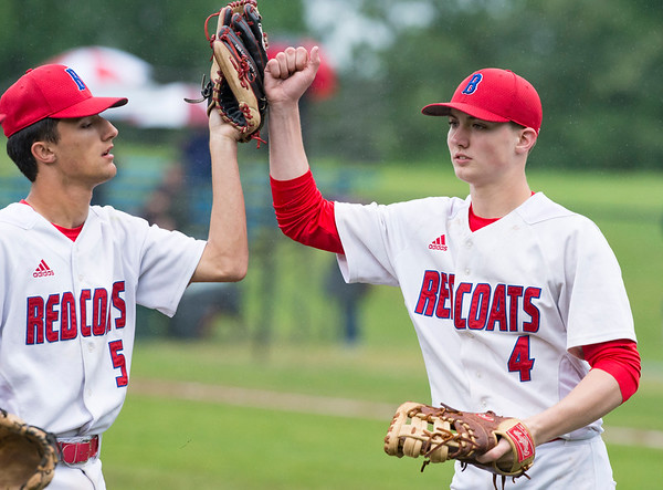 05/28/19 Wesley Bunnell | Staff Berlin baseball vs Weston in a Class L playoff game which was suspended due to rain after 5 1/3 innings with Berlin up 7-5. The game is scheduled to begin play again tomorrow at 4pm. Gianni Fanelli (5) is congratulated by Thomas Hyjek (4) after Fanelli made a running catch in center field to end the inning.
