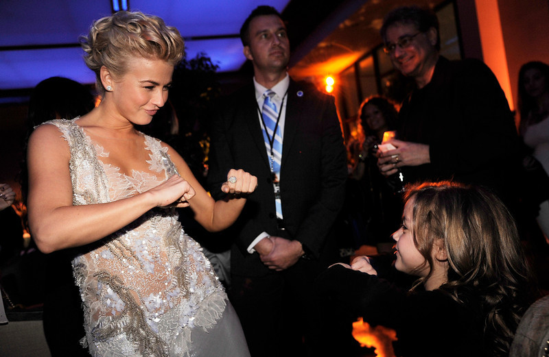 """. Julianne Hough, left, dances with fellow \""""Safe Haven\"""" cast member Mimi Kirkland at the post-premiere party for the film, Tuesday, Feb. 5, 2013, in the Hollywood section of Los Angeles. (Photo by Chris Pizzello/Invision/AP)"""