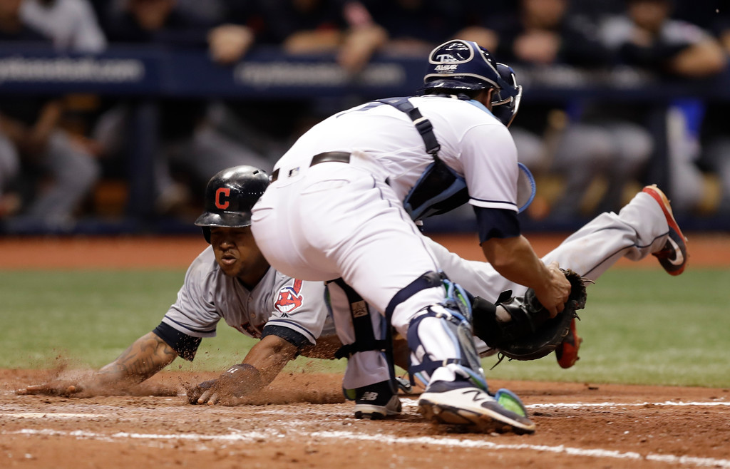 . Cleveland Indians\' Jose Ramirez scores ahead of the tag by Tampa Bay Rays catcher Nicholas Ciuffo on a fielder\'s choice by Yonder Alonso during the seventh inning of a baseball game Monday, Sept. 10, 2018, in St. Petersburg, Fla. (AP Photo/Chris O\'Meara)