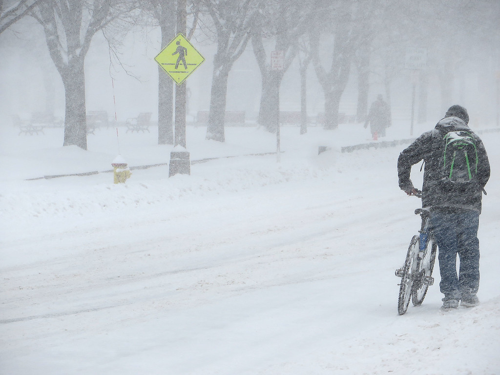 . A lone cyclist makes his way up Main Street in Fitchburg Tuesday morning. (Photo by Peter Jasinski)