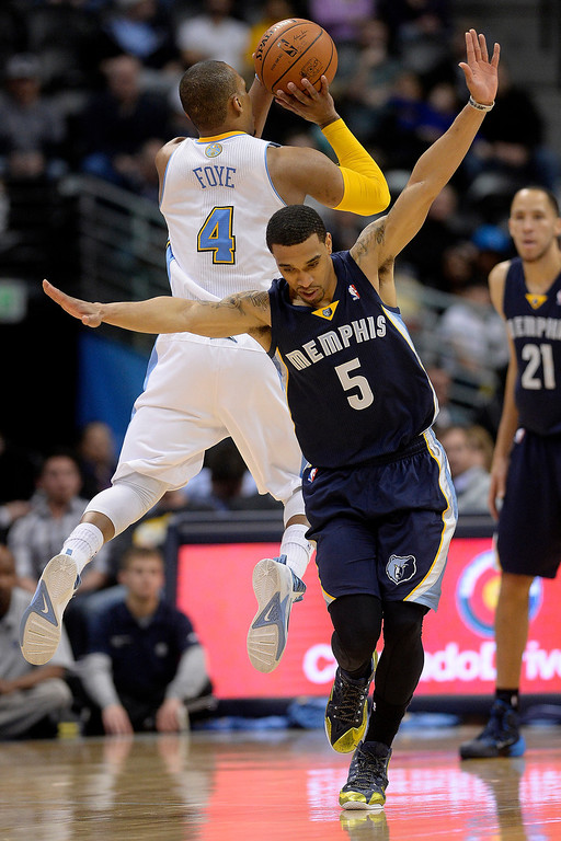 . Denver Nuggets guard Randy Foye (4) makes a shot after drawing a foul from Memphis Grizzlies guard Courtney Lee (5) during the third quarter of action. (Photo by AAron Ontiveroz/The Denver Post)