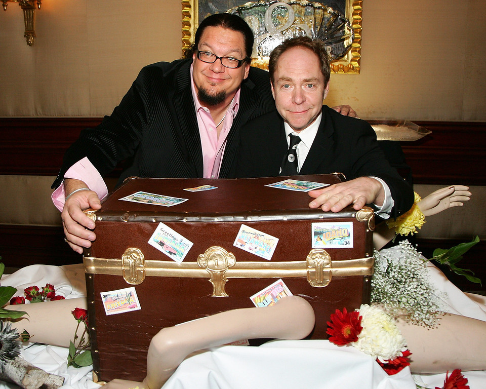 . LAS VEGAS - OCTOBER 18:  Penn Jillette (L) and Teller of the comedy/magic duo Penn & Teller pose with an oversized chocolate cake at the Rio Hotel & Casino during a reception celebrating five years of performances at the resort October 18, 2007 in Las Vegas, Nevada.  (Photo by Ethan Miller/Getty Images)