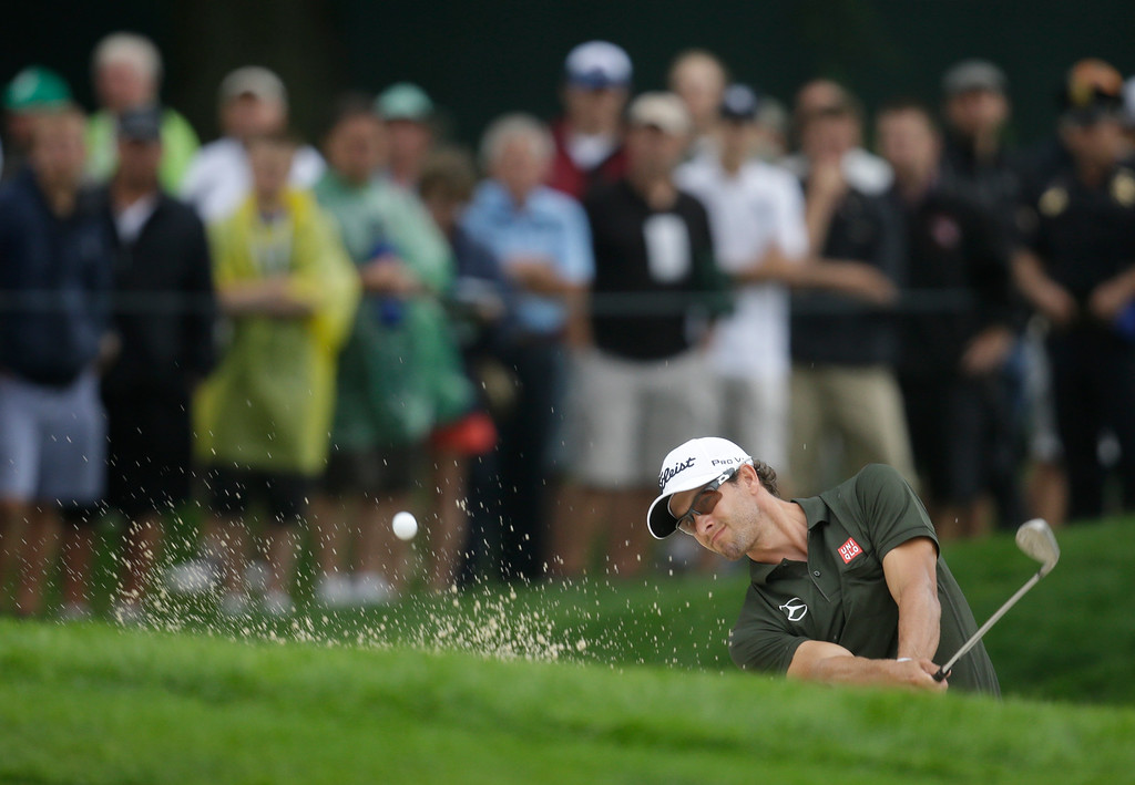 . Adam Scott, of Australia, hits out of a bunker on the fourth hole during the second round of the PGA Championship golf tournament at Oak Hill Country Club, Friday, Aug. 9, 2013, in Pittsford, N.Y. (AP Photo/Charlie Neibergall)