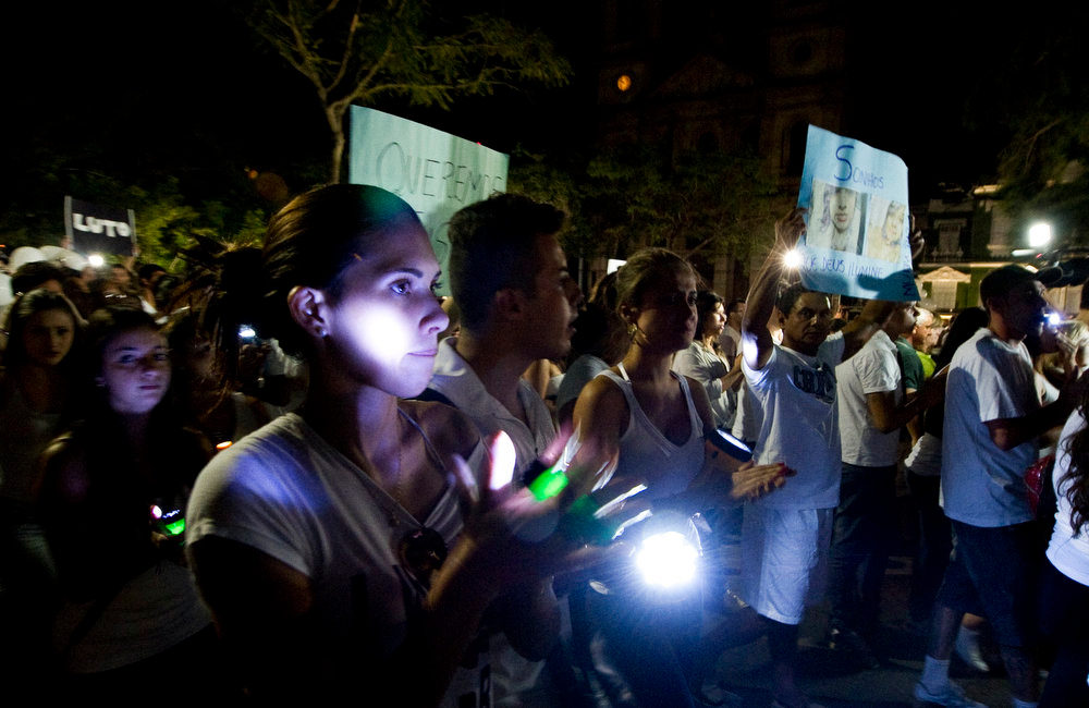 Description of . Residents of Santa Maria march along the Rio Branco avenue demanding justice and in homage to the victims of Kiss nightclub fire, on January 28, 2013, in Santa Maria, southern Brazil, where a blaze on the eve killed more than 230 people. Brazilian police arrested four suspects --two of the Kiss club's owners, along with a pair of musicians who starred in the ill-fated pyrotechnic show, in the wake of the nightclub fire that forced sports officials to defend preparations for the World Cup and Olympics. ANTONIO SCORZA/AFP/Getty Images