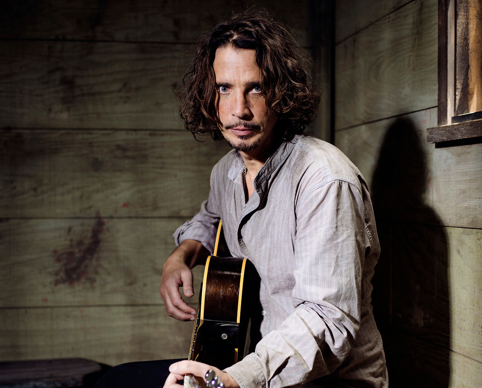 . FILE - In this July 29, 2015 file photo, Chris Cornell plays guitar during a portrait session at The Paramount Ranch in Agoura Hills, Calif. Cornell, 52, who gained fame as the lead singer of the bands Soundgarden and Audioslave, died at a hotel in Detroit and police said Thursday, May 18, 2017, that his death is being investigated as a possible suicide. (Photo by Casey Curry/Invision/AP, File)