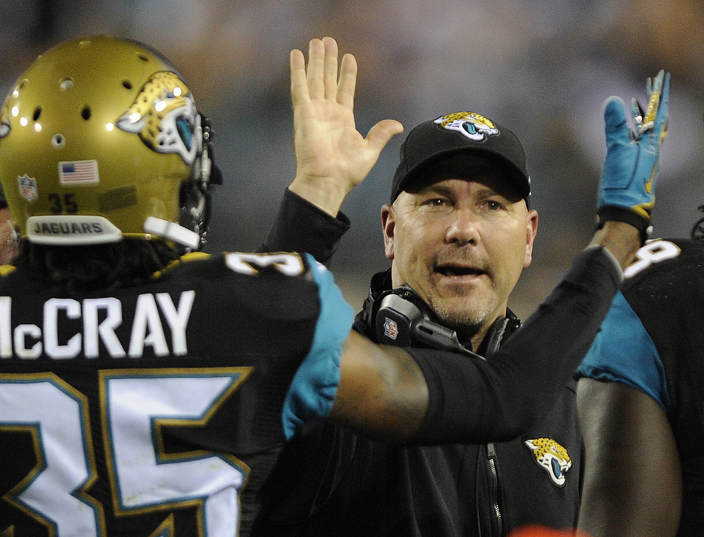 . Jacksonville Jaguars head coach Gus Bradley high fives cornerback Demetrius McCray (35) after a play against the Houston Texans during the second quarter of an NFL football game Thursday, Dec. 5, 2013, in Jacksonville, Fla. (AP Photo/Stephen Morton)