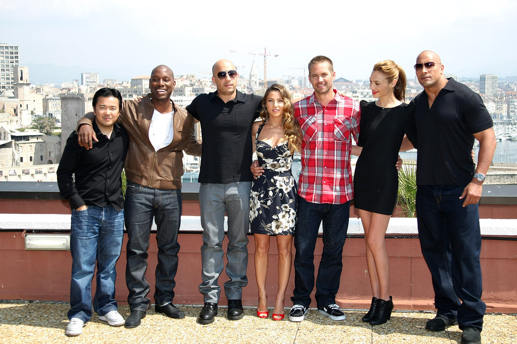 ". Taiwanese director Justin Lin, left, stands with actors Tyrese Gibson, Vin Diesel, Elsa Pataky, Paul Walker, Gal Gadot and Dwayne Johnson, from left, during a photocall to promote the film ""Fast and Furious 5: Rio Heist\"", in Marseille, southern France, Thursday, April 28, 2011. (AP Photo/Claude Paris)"