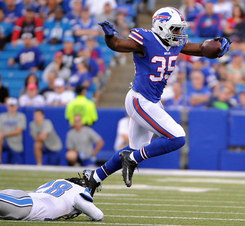. Buffalo Bills running back Bryce Brown, top, avoids a tackle by Detroit Lions cornerback Bill Bentley during the first half of a preseason NFL football game, Thursday, Aug. 28, 2014, in Orchard Park, N.Y. (AP Photo/Gary Wiepert)