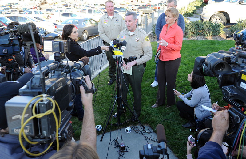 . San Bernardino County Sheriff John McMahon address the media out in front of Loma Linda Hospital, were two officers were taken after a shootout with ex-LADP Christopher Dorner, Tuesday, Feb 12, 2013. McMahon confirmed that one of the officers had died and the other was being treated at the hosiptal for his injuries.  San Bernardino County Sheriffs, assisted by multiple agencies from the region, block Highway 38 at Bryant St. were a gunfight betweeen police and Christopher Dorner took place further up the highway. Dorner shot two police officer, killing one and injuring the other, both men were transported to Loma Linda University Medical Center for treatment, Tuesday, Feb. 12, 2013.  (John Valenzuela/Staff Photographer)