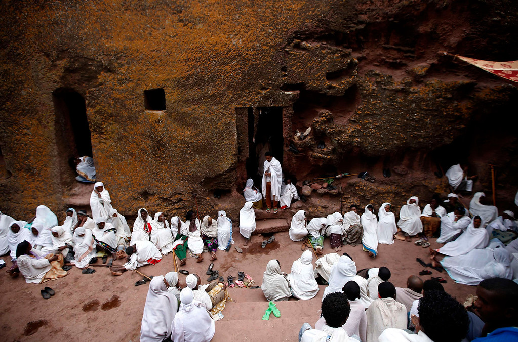 . Orthodox Christians pray outside the famous monolithic rock-cut churches during a Good Friday celebration in Lalibela May 3, 2013, REUTERS/Goran Tomasevic