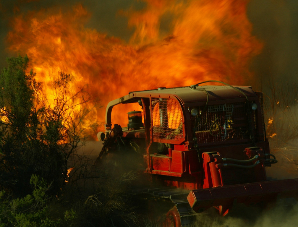 . 10-24-03...Val Verde Park fire...Photo of LA county dozer 7 as it make a head on attact to cut off the fire along on Del Valle rd.,  the Del Valle is 200+acre brush fire that is still burning, more info from fire dept.Photo by Gene Blevins/LA Daily news