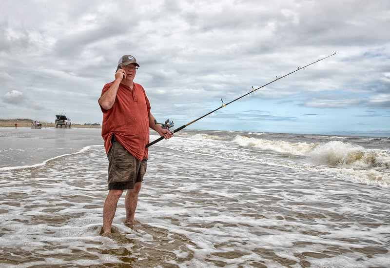 Dad Fishing on the Phone.jpg