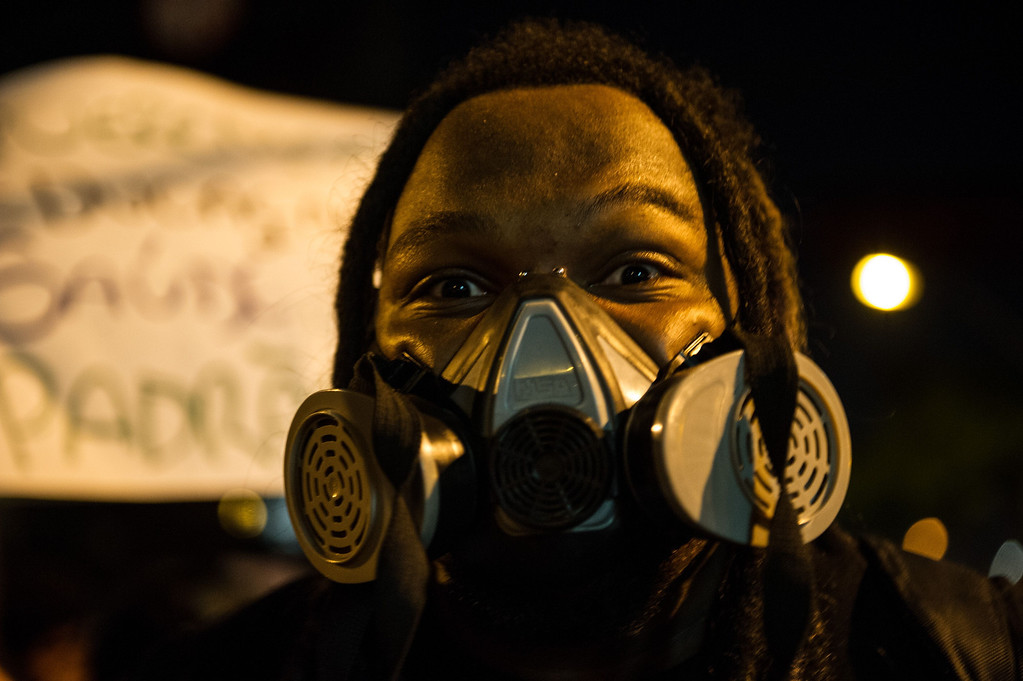 . A man wears in a gas mask during a demonstration in Belo Horizonte, Brazil, on June 21, 2013.  AFP PHOTO / YASUYOSHI  CHIBA/AFP/Getty Images