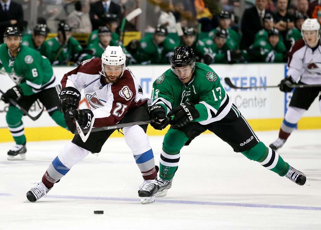 . Colorado Avalanche center Maxime Talbot (25) and Dallas Stars left wing Ray Whitney (13) compete for control of a loose puck in the second period of an NHL hockey game, Friday, Nov. 1, 2013, in Dallas. (AP Photo/Tony Gutierrez)