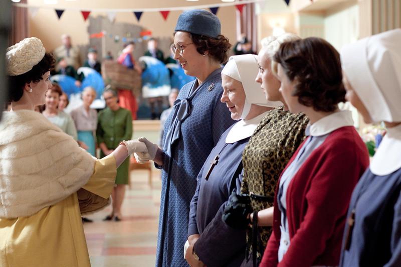 . Chummy (Miranda Hart), Sister Evangelina (Pam Ferris), Trixie (Helen George) and Jenny Lee (Jessica Raine) greeting Princess Margaret (SA) (Photo by Laurence Cendrowicz)