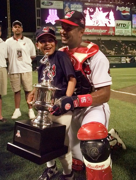. The Cleveland Indians\' Sandy Alomar shows off his MVP trophy with his son Marcus, after the All-Star Game Tuesday July 8, 1997, in Cleveland.  The American League won 3-1 after Alomar\'s seventh inning two-run home run.    (AP Photo/Beth A. Keiser)