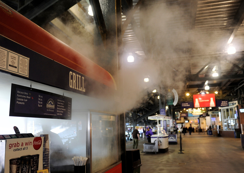 . Steam billows up and out of one of the Grills on the concourse along the third base at the  Denver  baseball park on May 3, 2013 before the Rockies game. (Photo By Cyrus McCrimmon/The Denver Post)