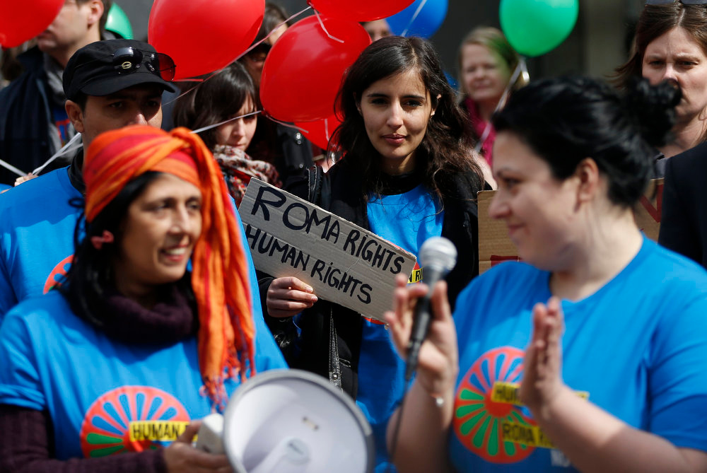 . A woman holds a sign during a protest against Romani evictions in front of the European Union Parliament to mark International Roma Day in Brussels on April 8, 2013.  REUTERS/Francois Lenoir