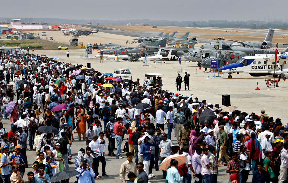 Description of . Visitors crowd at the static display area for aircraft on the third day of the Aero India 2013 at Yelahanka air base in Bangalore, India, Friday, Feb. 8, 2013. More than 600 aviation companies along with delegations from 78 countries are participating in the five-day event that started Wednesday. (AP Photo/Aijaz Rahi)