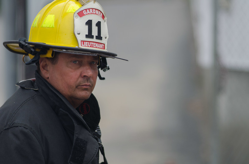 Gardner Lt Butch Sharron surveys the scene at the rear of the building during a 6 Alm fire on Sherman St.