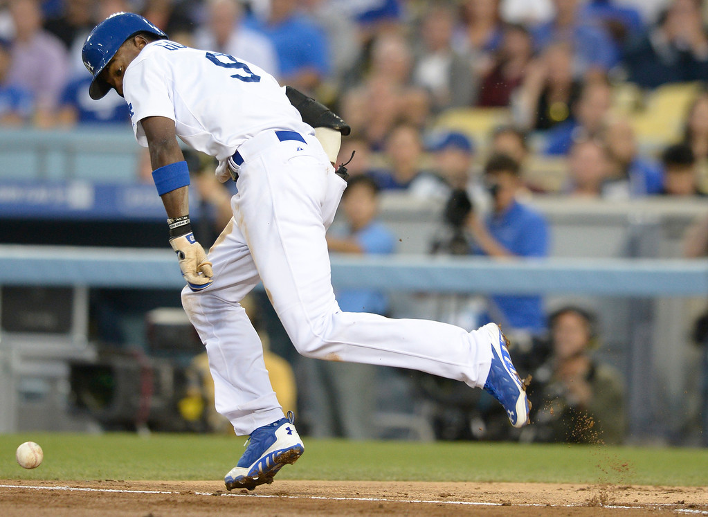 . Dee Gordon keeps an eye on the ball while running to first in the 3rd inning. Gordon was thrown out on the play. The Dodgers played the Colorado Rockies at Dodger Stadium in Los Angeles, CA. 6/18/2014(Photo by John McCoy Daily News)