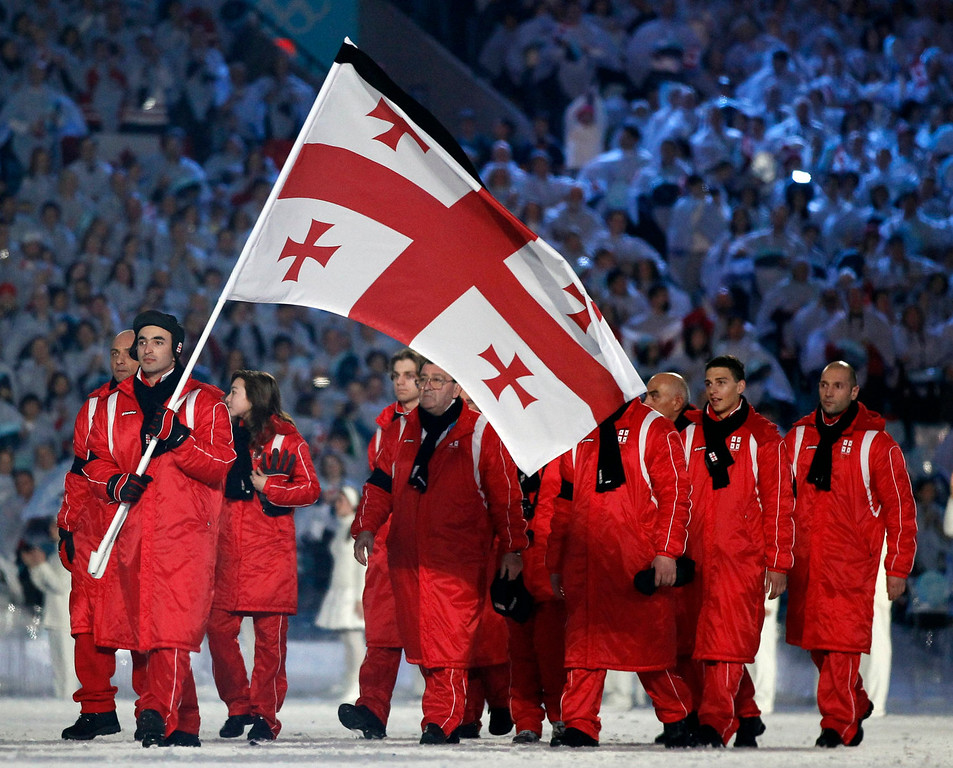 . Georgia\'s Iason Abramashvili carries the flag wearing a black armband in memory of Nodar Kumaritashvili of Georgia, who died during luge training on Friday, during the opening ceremony for the Vancouver 2010 Olympics in Vancouver, British Columbia, Friday, Feb. 12, 2010. (AP Photo/Mark Baker)
