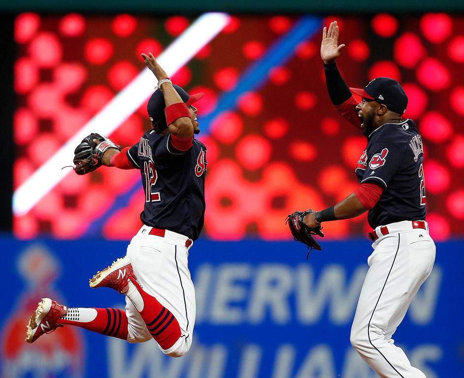 . Cleveland Indians\' Francisco Lindor, left, and Austin Jackson celebrate a 2-0 victory over the Detroit Tigers in a baseball game, Tuesday, Sept. 12, 2017, in Cleveland. (AP Photo/Ron Schwane)