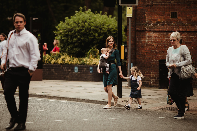 Izmi_Baby_Carrier_Mid_Grey_Lifestyle_Side_Carry_Crossing_Road.jpg