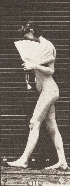 Nude woman walking, flirting a fan and turning around