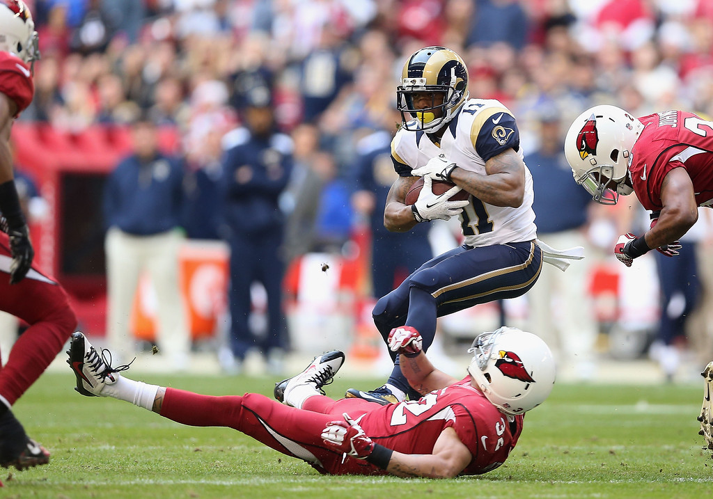 . Wide receiver Tavon Austin #11 of the St. Louis Rams runs with the football after a reception past free safety Tyrann Mathieu #32 of the Arizona Cardinals during the NFL game at the University of Phoenix Stadium on December 8, 2013 in Glendale, Arizona.  (Photo by Christian Petersen/Getty Images)
