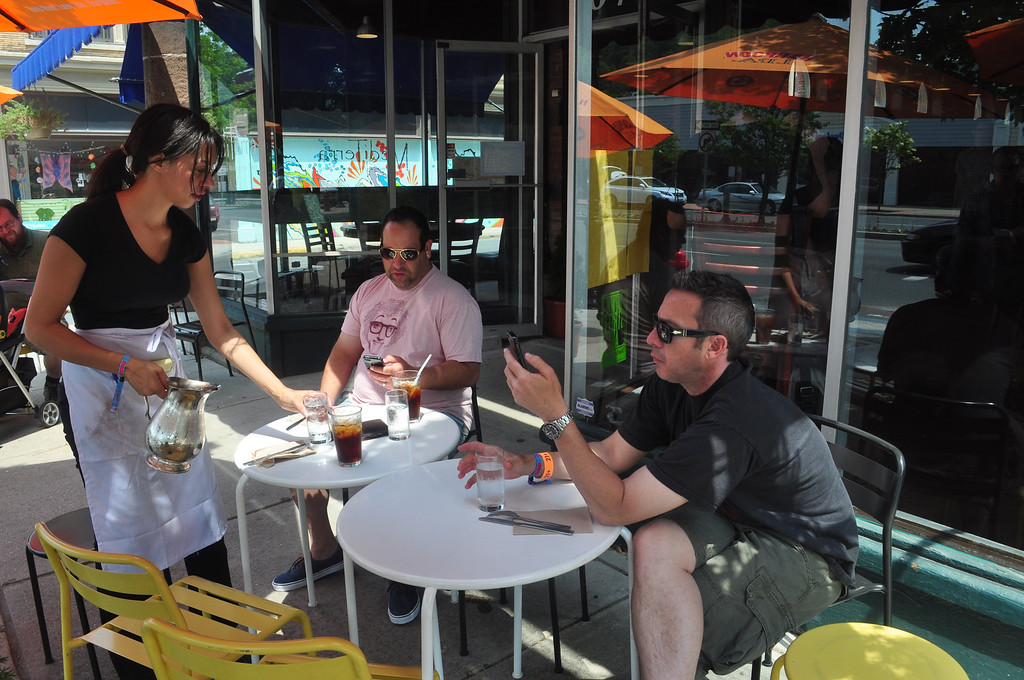 . Jack Guerino/ North Adams Transcript Mike Gellman from Colorado and Ron Diamond from Baltimore enjoy an early lunch at Mediterra before Saturday�s events at the Solid Sound Festival.