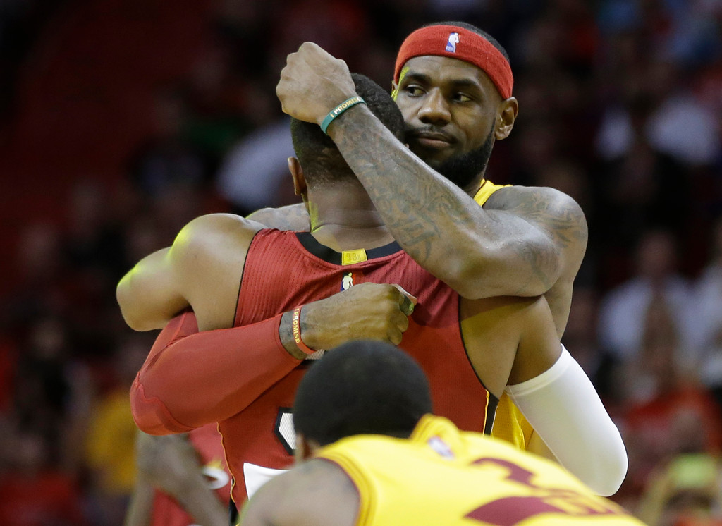 . Cleveland Cavaliers forward LeBron James, right, hugs Miami Heat guard Dwyane Wade before an NBA basketball game, Thursday, Dec. 25, 2014, in Miami. (AP Photo/Lynne Sladky)