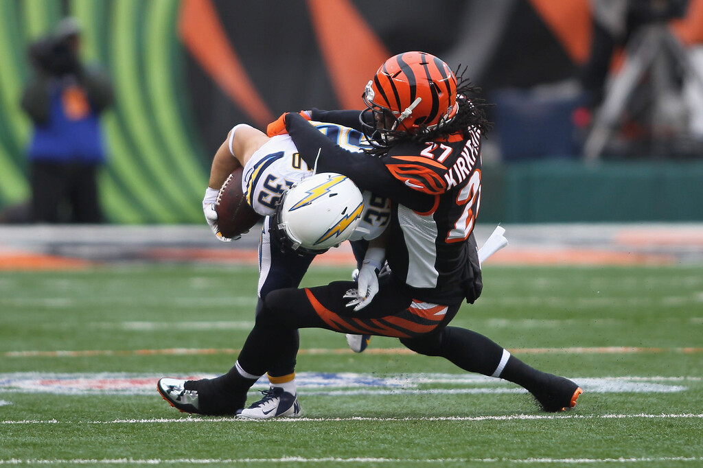 . Dre Kirkpatrick #27 of the Cincinnati Bengals tackles Danny Woodhead #39 of the San Diego Chargers during their AFC Wild Card playoff game at Paul Brown Stadium on January 5, 2014 in Cincinnati, Ohio.  (Photo by John Grieshop/Getty Images)