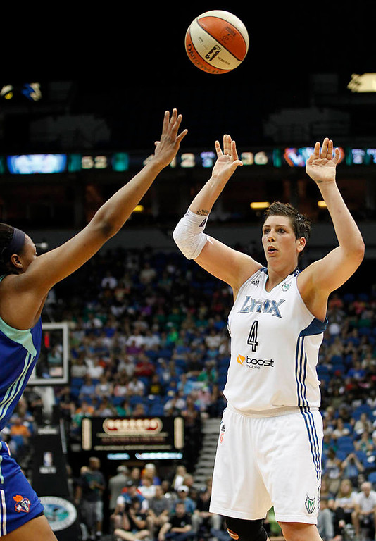 . Minnesota Lynx forward Janel McCarville  passes the ball over New York Liberty forward Kelsey Bone in the second half. The Lynx won 88-57. (AP Photo/Stacy Bengs)