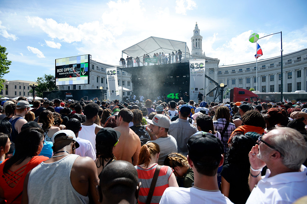 . Festival goers pile in front of the main stage waiting eagerly for 4:20PM and Wiz Khalifa to perform during the Denver 420 Rally held Saturday at Civic Center Park. (Photo by Kira Horvath/ The Denver Post)