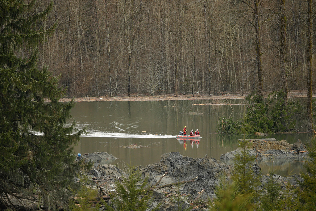 . A search and rescue team navigates the water during operations on March 27, 2014 in Oso, Washington.  (Photo by Ted S. Warren-Pool/Getty Images)